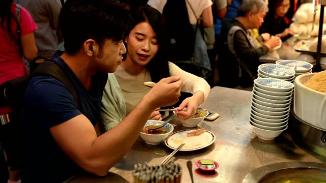 asian couple enjoying a night market - taipei stock videos & royalty-free footage