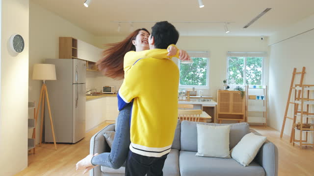 asian couple hug together - warm clothing stock videos & royalty-free footage