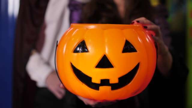 asian couple love holding halloween pumpkins and candles in halloween party - dungeon stock videos & royalty-free footage