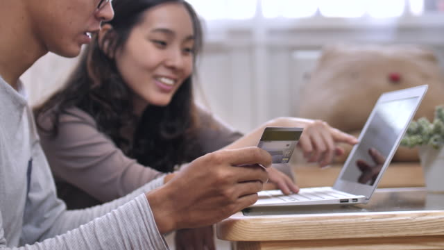 Asian Couple making online shopping