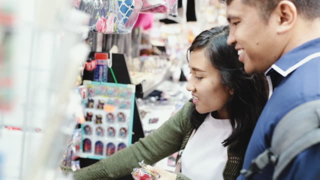 asian couple shopping in tokyo - mid adult couple stock videos & royalty-free footage