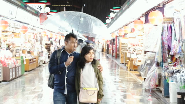 asian couple traveling asakusa in tokyo - mid adult couple stock videos & royalty-free footage