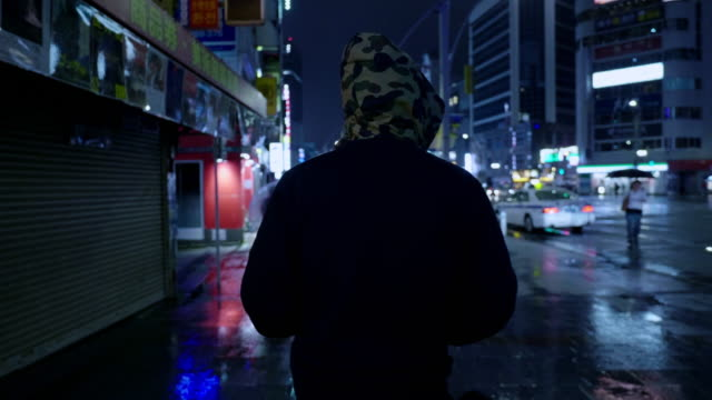 asian couple traveling in japan rainy using umbrella - alley stock videos & royalty-free footage