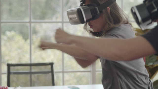 asian couple using 3-d glasses in boxing vr gaming at home - strike industrial action stock videos & royalty-free footage