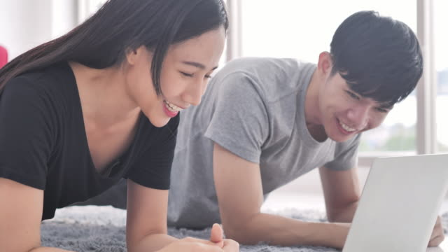 asian couples training at home, doing plank and watching videos on laptop, training in living room.exercising, healthy lifestyle, indoors, domestic room, stay at home - saying, bodyweight training, family, technology,home exercise - husband stock videos & royalty-free footage