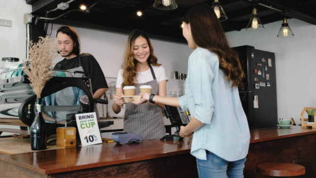 asian customer order coffee from tablet and use mobile phone pay contactless with tablet at counter bar in cafe.small business start up.customer service concept - booth stock videos & royalty-free footage