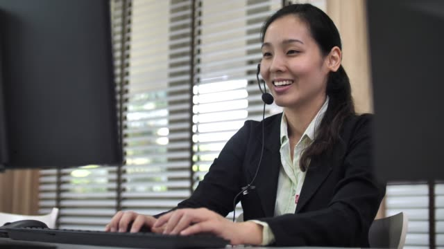 asian customer support working with customer - headset stock videos & royalty-free footage