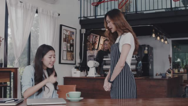 asian customer woman complain about the coffee shop staff. that the coffee taste is not tasty at table in coffee shop background.concept of cafe and coffee shop small business problem. - korean ethnicity stock videos & royalty-free footage
