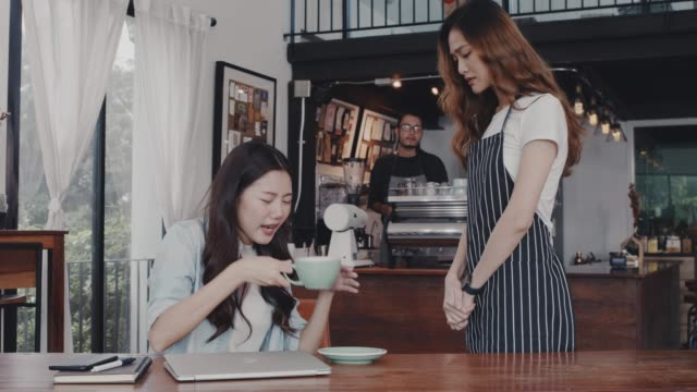asian customer woman complain about the coffee shop staff. that the coffee taste is not tasty at table in coffee shop background.concept of cafe and coffee shop small business problem. - coffee shop background stock videos & royalty-free footage