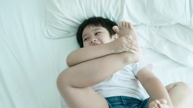 Asian cute baby boy trying stretching her leg while open her leg with positive emotion