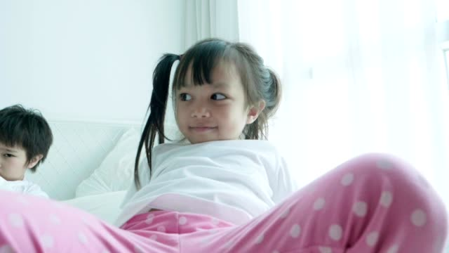 Asian cute baby girl trying to jumping while open her leg with positive emotion