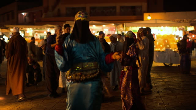 a oriental dancer at jemaa el fna. - street performer stock videos and b-roll footage