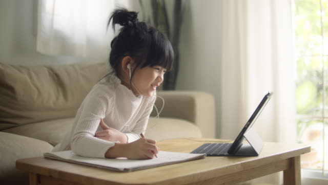 asian daughter attending to online class from home. - learning stock videos & royalty-free footage