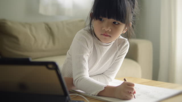 asian daughter attending to online class from home. - touchpad stock videos & royalty-free footage