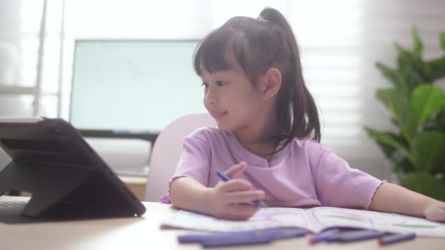 asian daughter learning to online class on digital tablet from home - pencil isolated stock videos & royalty-free footage