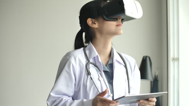 asian doctor using vr glasses, virtual reality headset for healthcare - cyberspace stock videos & royalty-free footage