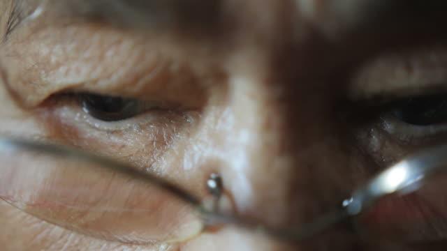 Asian elder woman eyes close up