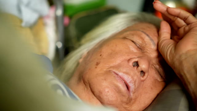 asian elderly woman sleeping on the bed. - patient journey stock videos & royalty-free footage