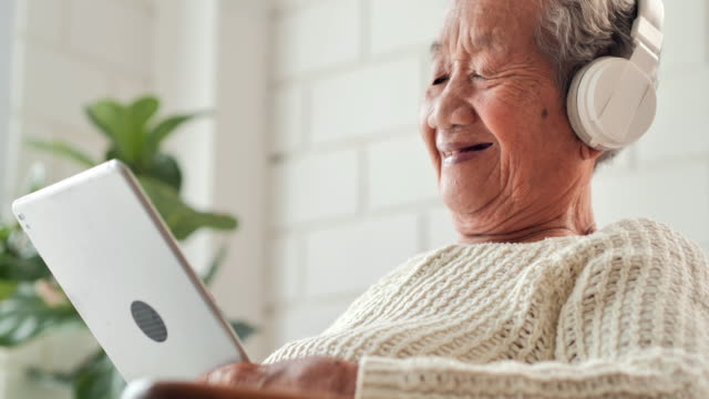 asian elderly women using tablet information search about coronavirus or covid-19 virus at home to prevent epidemics.senior technology,elderly,retirement,lifestyle,heathcare and medicine,south east and east asia: people aged 50+,coronavirus or covid-19 - headphones stock videos & royalty-free footage
