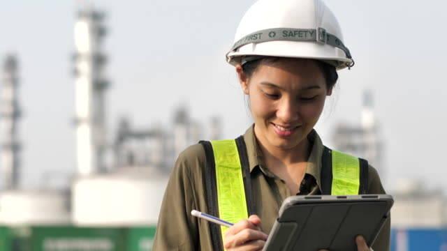 asian engineer woman working on digital tablet - authority stock videos & royalty-free footage