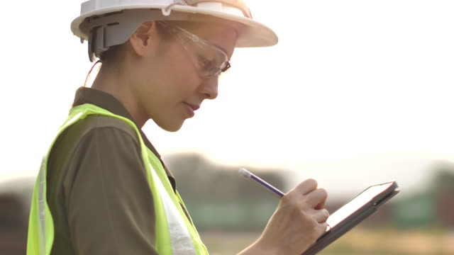 asian engineer woman working with digital tablet - hard hat stock videos & royalty-free footage