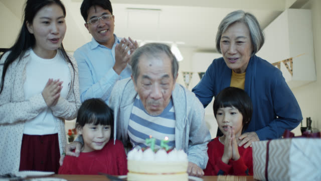 asian family celebrating grandfather's birthday - birthday candle stock videos & royalty-free footage