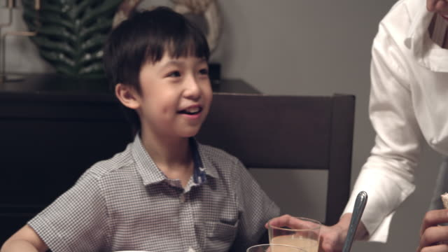 asian family eating - two parents stock videos & royalty-free footage