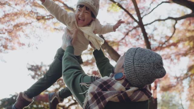 asian family enjoying on vacation autumn season at japan s - moving up stock videos & royalty-free footage