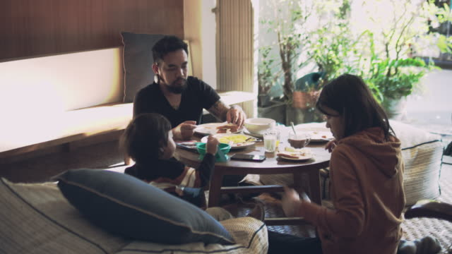 Asian family have breakfast