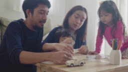 Asian family have fun and playing wood toy at home