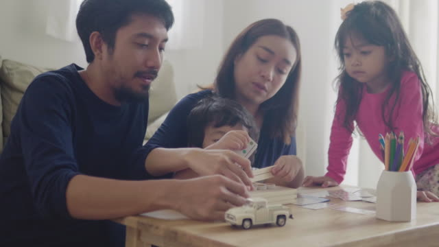 asian family have fun and playing wood toy at home - board game stock videos & royalty-free footage