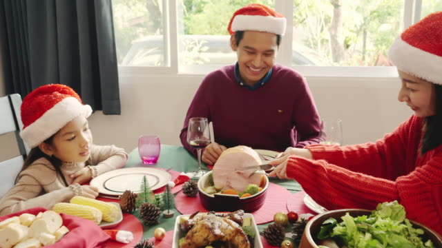 asian family having dinner on christmas eve. - roast dinner stock videos & royalty-free footage