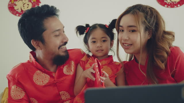asian family is video call with family. - red stock videos & royalty-free footage