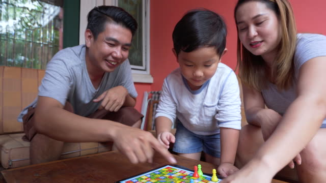 asian family lifestyle enjoy playing game at home - leisure games stock videos & royalty-free footage