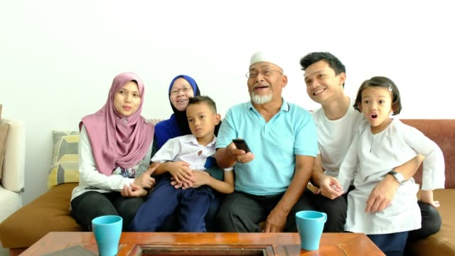 asian family on the couch watching tv - malaysia stock videos & royalty-free footage