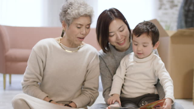 asian family reading together - ethnicity stock videos & royalty-free footage