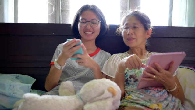 asian family using digital tablet and smart phone do their work at home and relax with online shopping - south east asian ethnicity stock videos and b-roll footage