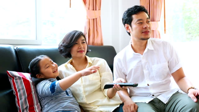asian family watching tv ideo. - family watching tv stock videos and b-roll footage