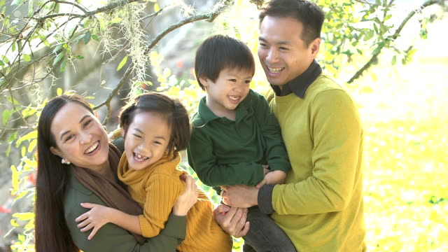 asian family with two children at the park - family with two children stock videos & royalty-free footage