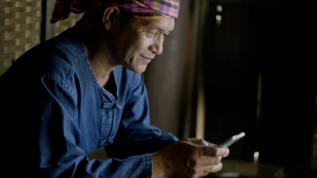 asian farmer with agriculture app on smart phone - developing countries stock videos & royalty-free footage