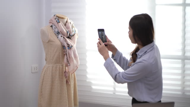asian fashion designer takes photo of a dressed in her studio ,small business - designer clothing stock videos & royalty-free footage