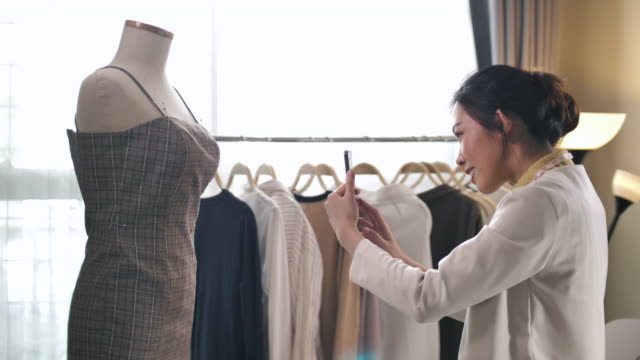 asian fashion designer taking photography on clothing send to her customer - designer clothing stock videos & royalty-free footage