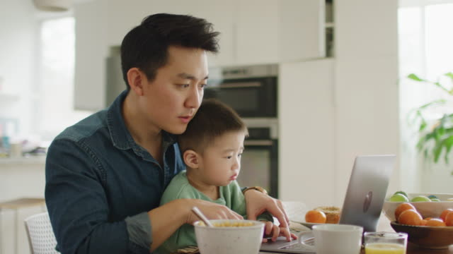 asian father and son. - dining room stock videos & royalty-free footage