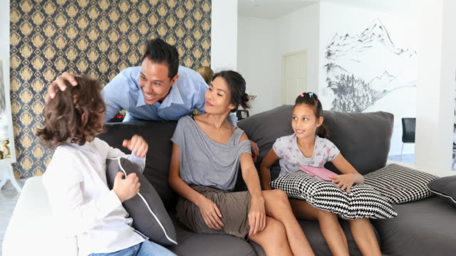 Asian Father Coming Home to Watch TV With His Family