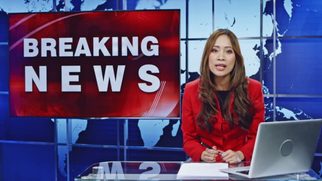 ld asian female anchor presenting breaking news - breaking news stock videos and b-roll footage