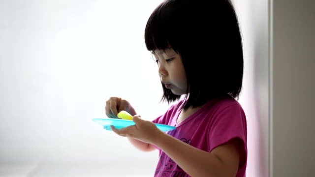 Asian female child eating ice-cream