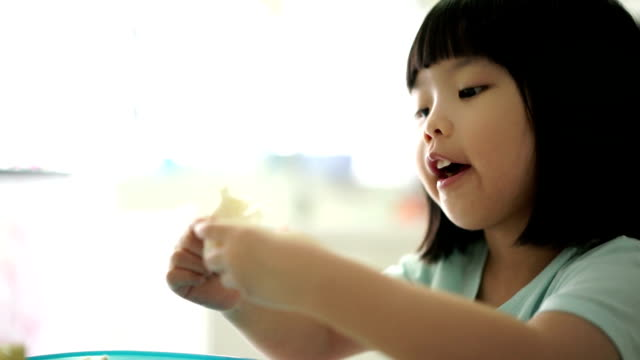 asian female child enjoying her breakfast - cheese stock videos & royalty-free footage