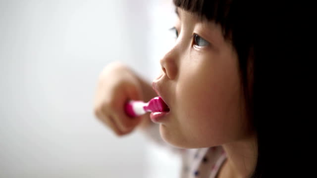 asian female child enjoying her tooth brushing routine - toothpaste stock videos and b-roll footage