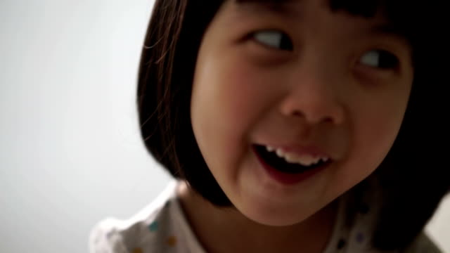 asian female child enjoying her tooth brushing routine - toothpaste stock videos & royalty-free footage