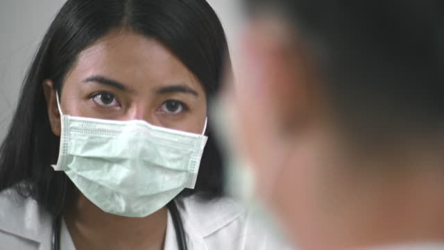 asian female doctor working - asian man coughing stock videos & royalty-free footage